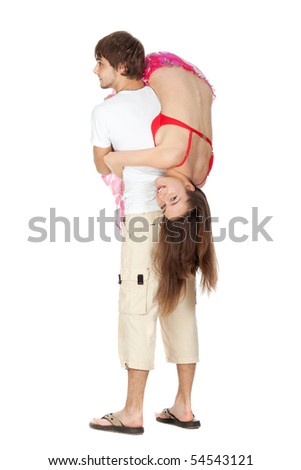 Young happy couple in beach clothes playing together piggyback isolated on white - stock photo