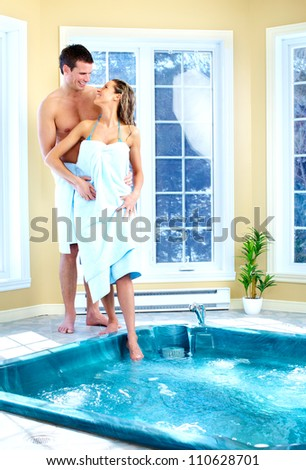 Young happy couple in jacuzzi. Spa relax. - stock photo