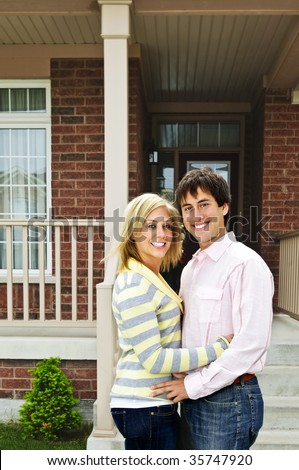 Young happy couple in love at home - stock photo