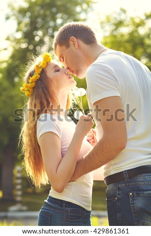 Young happy couple in love outdoors. loving man and woman on a walk in a spring park