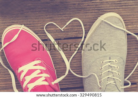 Young happy couple in love with their shoes. - stock photo