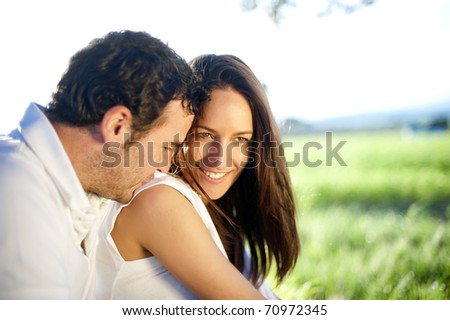 Young happy couple in nature - stock photo