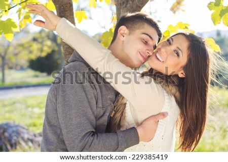 Young happy couple in the  park - stock photo