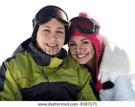 Young happy couple in winter clothes and goggles