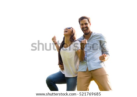 young happy couple isolated on white background