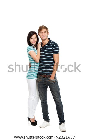 Young happy couple love smiling, standing full length portrait, looking at camera, isolated over white background - stock photo