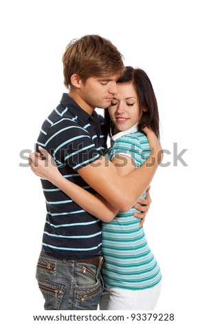 Young happy couple love smiling, with closed eyes, hug each other, isolated over white background - stock photo