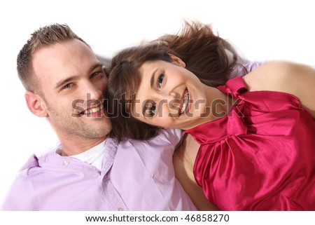 Young, happy couple lying on the floor and laughs