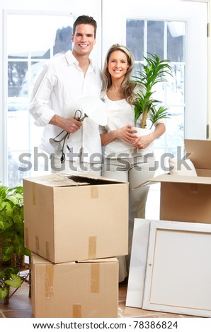 Young happy couple  moving into their new home
