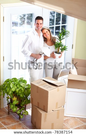 Young happy couple  moving into their new home - stock photo