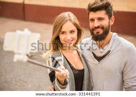 Young happy couple on a walk in the city