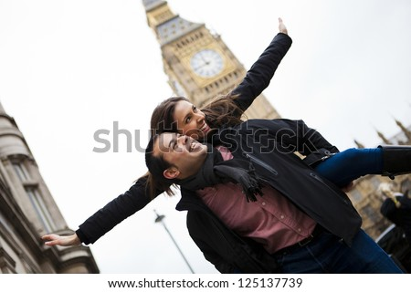 Young happy couple on their honeymoon in London. - stock photo