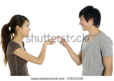 Young happy couple on white background - stock photo