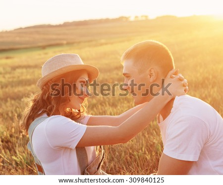 young happy couple outdoor - stock photo