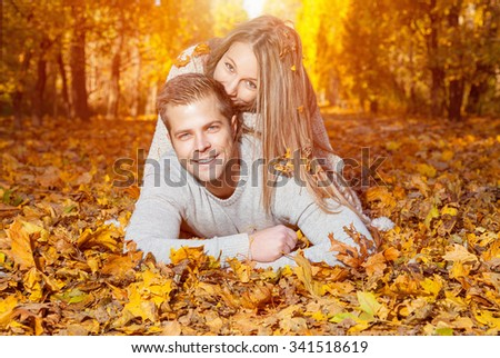 Young happy couple outdoors in autumn - stock photo