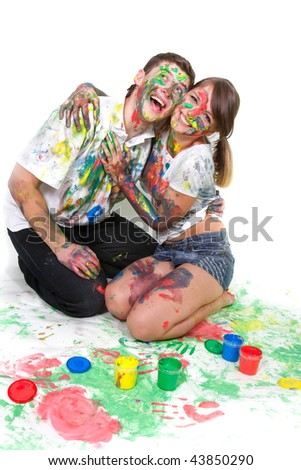 young happy couple painting over white - stock photo