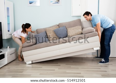 Moving furniture stock images royalty free images for Young couple living room ideas