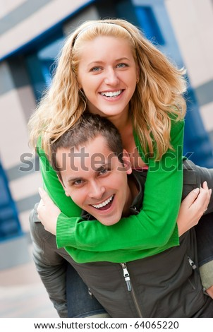 Young happy couple portrait in a city - stock photo