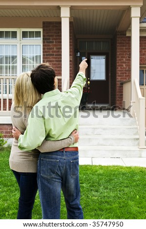 Young happy couple shopping for new home - stock photo