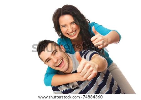 Young happy couple showing ok - stock photo