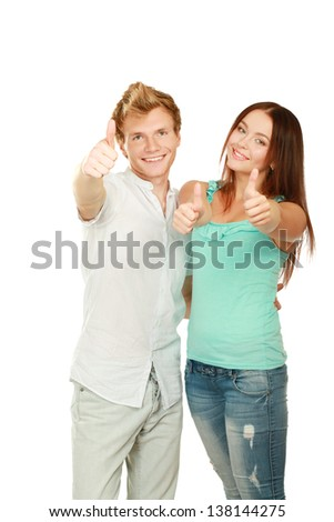 Young happy couple showing ok, isolated on white background - stock photo