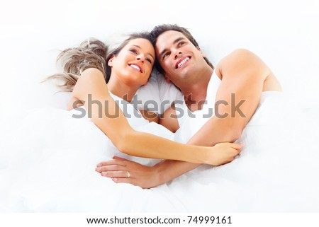 Young happy couple sleeping in bed. Love. - stock photo
