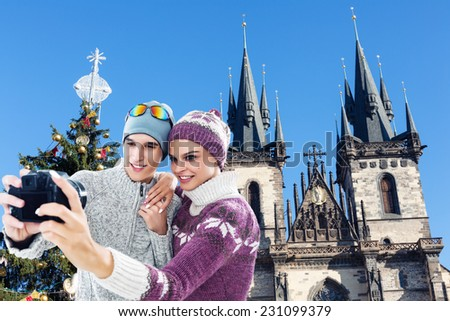 Young, happy couple taking a self portrait, selfie in the Prague, Czech Republic, Christmas and New Year's holidays, winter season - stock photo