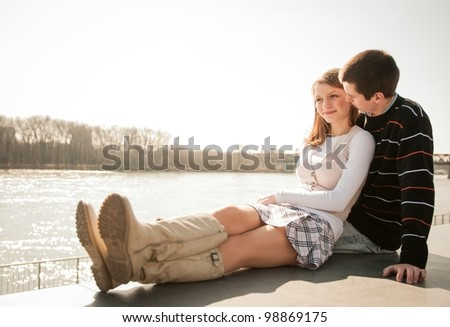 Young happy couple together  - outdoor lifestyle portrait