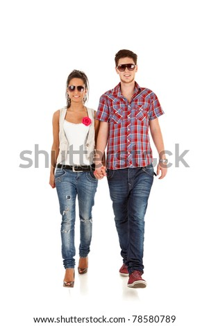 Young happy couple walking - full length portrait over white background