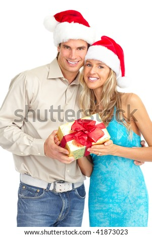 Young happy couple with a Christmas gift. Isolated over white background - stock photo