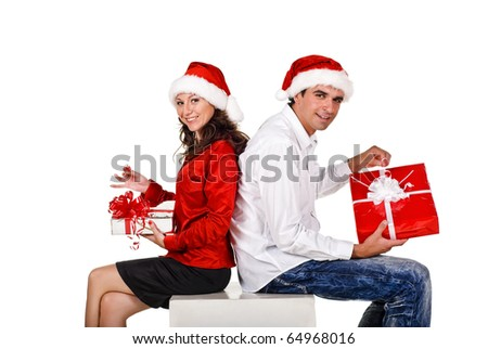 Young happy couple with a Christmas gifts. Isolated over white background