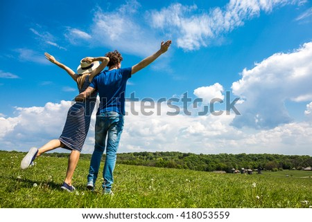 Young happy couple with blue sky on the background, Tourism concept