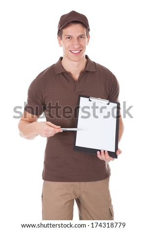 Young Happy Delivery Man Showing Form On Clipboard Over White Background - stock photo