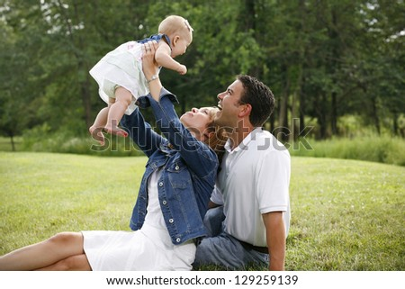 Young Happy Family - stock photo