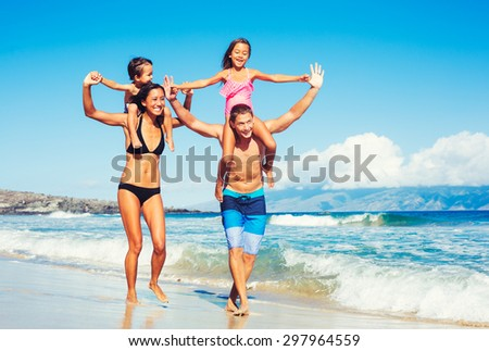 Young Happy Family Having Fun at the Beach Outdoors - stock photo
