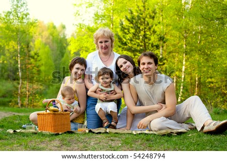young happy family having picnic in the nature - stock photo