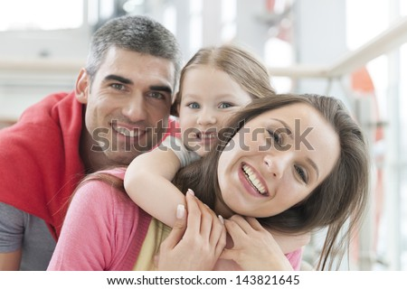 Young happy family in shopping mall - stock photo