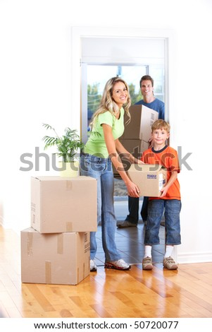 Young happy family moving into their new home - stock photo