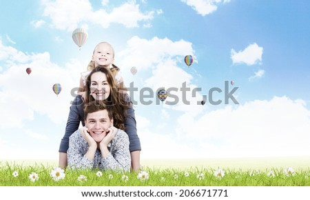 Young happy family of father mother and daughter