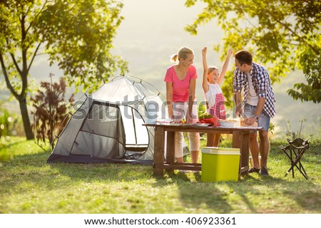 young happy family on vacation in nature