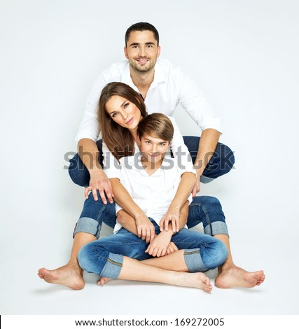 Young happy family on white background - stock photo