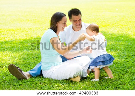 young happy family playing outdoors