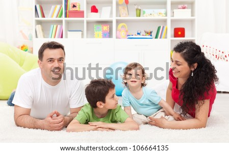 Young happy family playing together in the kids room