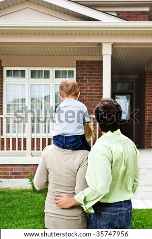 Young happy family shopping for new home - stock photo
