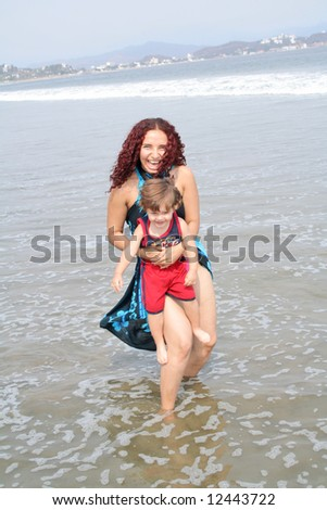 Young happy family together on the beach