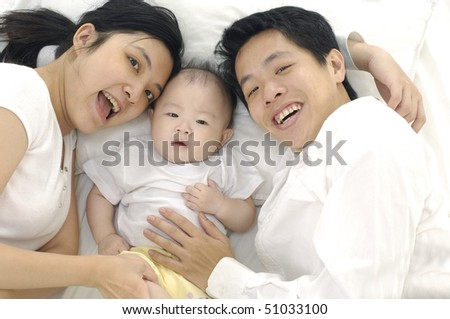 young happy family with beautiful baby - stock photo