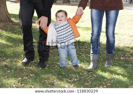 young happy family with child, outdoor portrait on natural background - stock photo