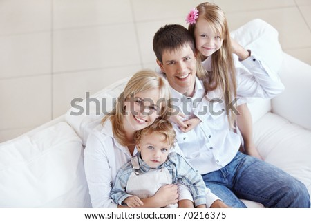 Young happy family with two children