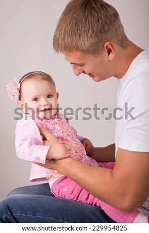 Young happy father with baby - stock photo