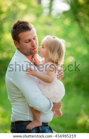Young happy father with baby girl - stock photo
